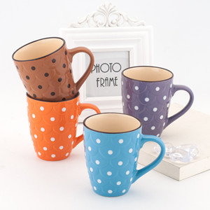 Embossed ceramic mug with dots painted